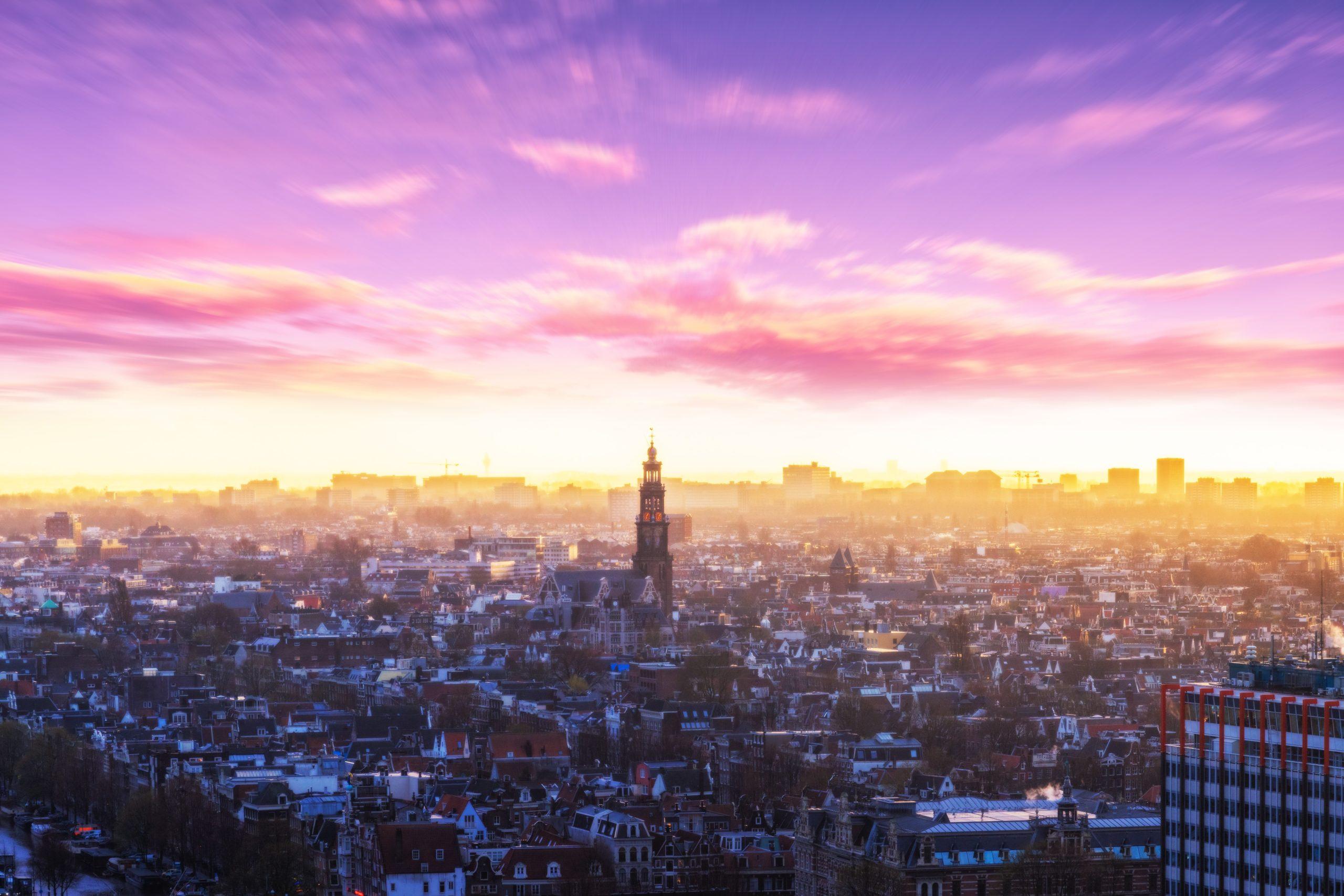 zon en horizon boven Amsterdam - foto door Bart Ros
